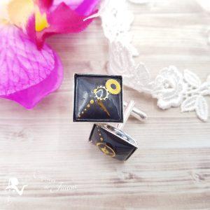 Boutons de manchette steampunk avec engrenage noir et doré